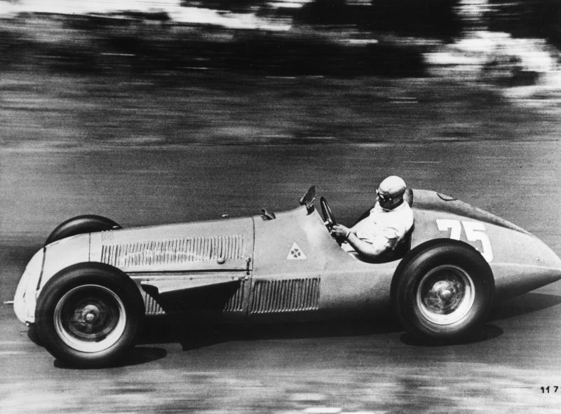 FILE - In this July 29, 1951, file photo, World Champion Juan Manuel Fangio races an Alfa Romeo Tipo 158/159 'Alfetta' in the German Grand Prix at Nurburg, Germany. More than 60 years since Fangio was conquering race tracks in the 1950s, Lewis Hamilton can match Fangio's five championships at the Mexican Grand Prix. Hamilton marvels at the cars Fangio drove. He's taken some laps in some of the classic cars of Fangio's era was impressed by the sheer courage it took to race them. Fangio and drivers had nothing like the protective cockpit today's drivers have. (AP Photo/File)