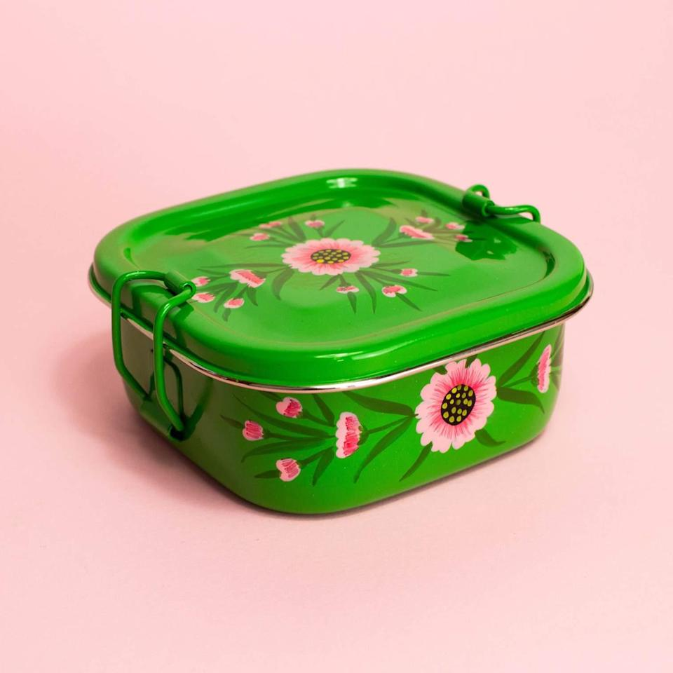 """This cheery stainless steel tiffin with a romantic floral motif has an equally uplifting backstory. Based in Moradabad, India, Noah's Ark runs three schools to provide its artisans' families with educational opportunities, along with free healthcare, and access to clean water. $32, GlobeIn. <a href=""""https://shop.globein.com/products/round-tiffin-green-floral?"""" rel=""""nofollow noopener"""" target=""""_blank"""" data-ylk=""""slk:Get it now!"""" class=""""link rapid-noclick-resp"""">Get it now!</a>"""