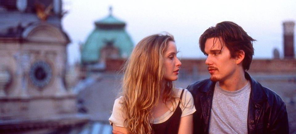"""<p>A French student (Julie Delpy) and an American wanderer (Ethan Hawke) meet on a train, and spend an enchanted day roaming around Vienna until their other obligations pierce the bubble they've created. This simple plot summary hardly touches the magic of this film, which builds connection the way it's built in real life: Through conversation and an ineffable spark. BRB, booking one of these<a href=""""http://www.oprahmag.com/life/g25736964/scenic-train-rides-routes/"""" rel=""""nofollow noopener"""" target=""""_blank"""" data-ylk=""""slk:scenic train routes"""" class=""""link rapid-noclick-resp""""> scenic train routes</a> because... you never know. For the full effect, watch the entire trilogy, which tracks Jesse and Celine over the years.</p><p><a class=""""link rapid-noclick-resp"""" href=""""https://www.amazon.com/Before-Sunrise-Ethan-Hawke/dp/B001NA6096?tag=syn-yahoo-20&ascsubtag=%5Bartid%7C10072.g.33383086%5Bsrc%7Cyahoo-us"""" rel=""""nofollow noopener"""" target=""""_blank"""" data-ylk=""""slk:Watch Now"""">Watch Now</a></p>"""