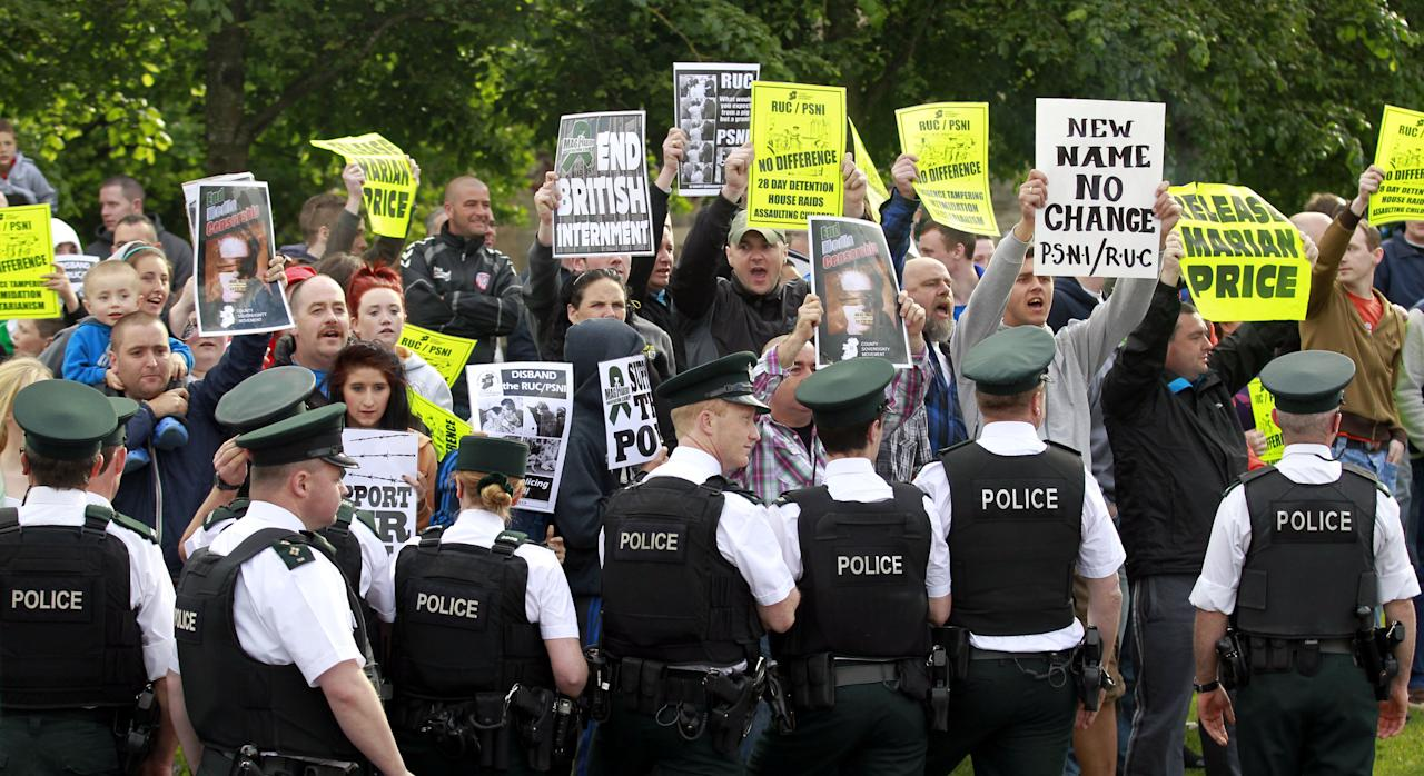 Irish Republican's protest as the Olympic torch tries to pass in Londonderry, Northern Ireland, Monday, June 4, 2012. Dissident Republican protesters caused the Olympic torch to be rerouted Monday. (AP Photo/Peter Morrison)
