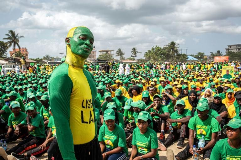 Supporters of the Tanzanian ruling party Chama Cha Mapinduzi gather at the Kibanda Maiti Stadium during the last campaign rally