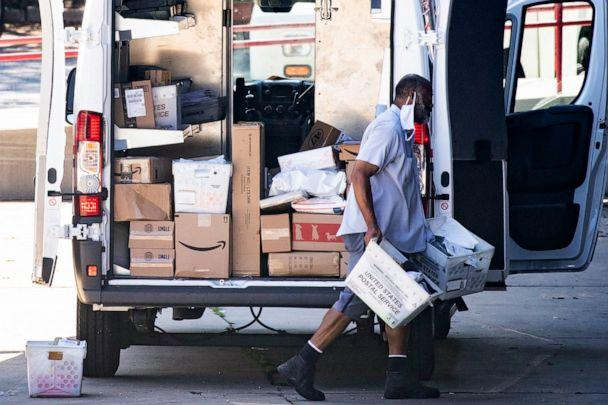 PHOTO: A mail carrier loads a truck before leaving for deliveries at a United States Postal Service (USPS) processing and distribution center in Riverdale, Maryland, Aug. 17, 2020. (Michael Reynolds/EPA via Shutterstock)
