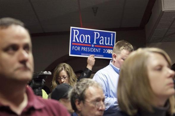 A supporter holds a sign at Ron Paul's announcement of an exploratory committee in Des Moines, Iowa April 26, 2011. (REUTERS/Brian C. Frank)