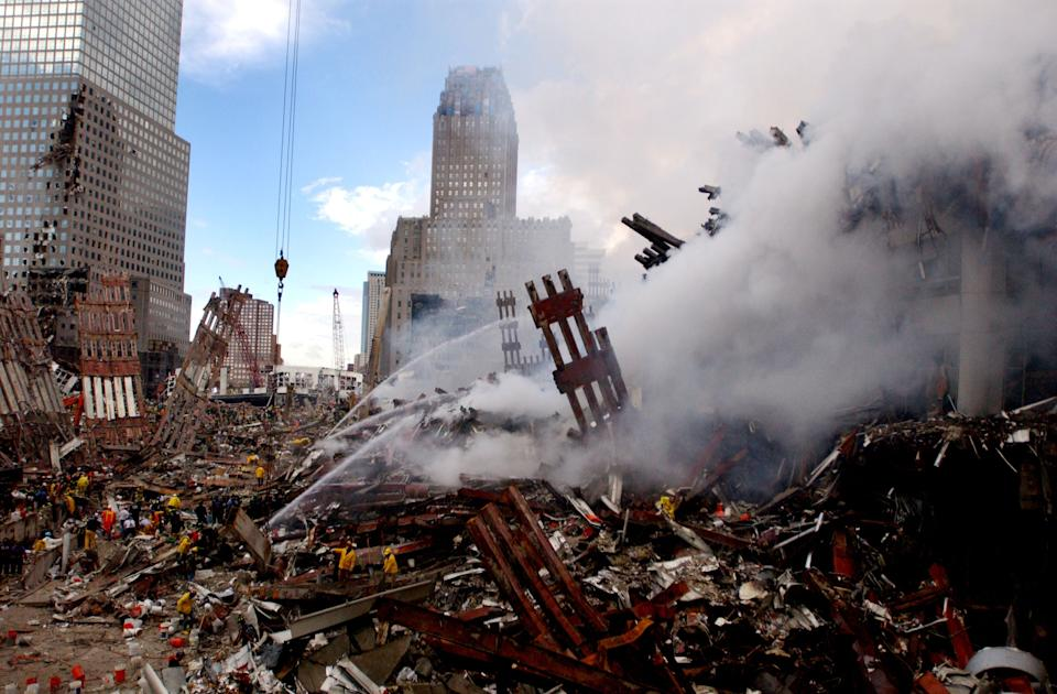 Fires burn amidst the rubble of the World Trade Center on September 13, 2001, days after the September 11, 2001 terrorist attack. (U.S. Navy Photo by Jim Watson/Getty Images)