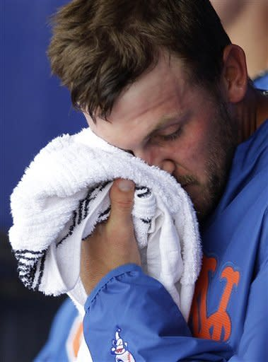 New York Mets starting pitcher Jonathon Niese wipes his face in the dugout after being relieved in the sixth inning of a spring training baseball game against the New York Yankees in Port St. Lucie, Fla., Tuesday, April 3, 2012. Niese allowed five runs in the sixth inning. (AP Photo/Patrick Semansky)
