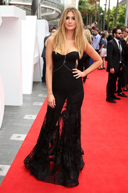 <p><b>Delta Goodrem</b> The Aussie singer looks glowing in this sheer black gown on the ARIAs red carpet. We're suspecting a nod to Beyonce with the body chain Delta is rocking.</p>