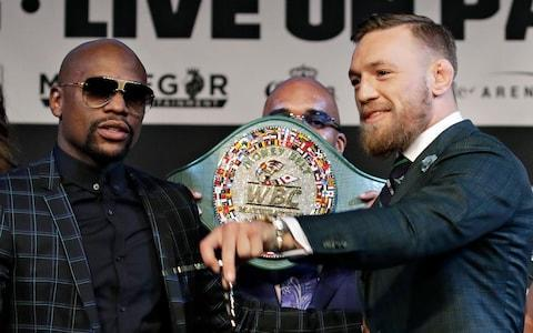 <span>Floyd Mayweather and Conor McGregor pose for photos alongside the new WBC 'Money' belt</span> <span>Credit: AP&nbsp; </span>