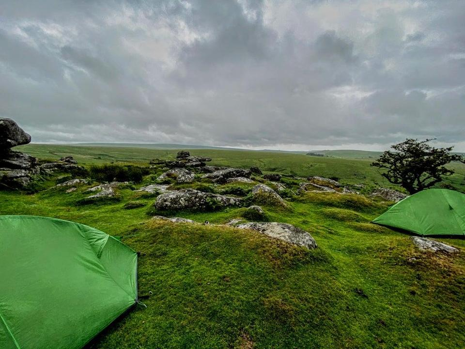 Camping on Dartmoor as clouds gather (Megan Eaves)