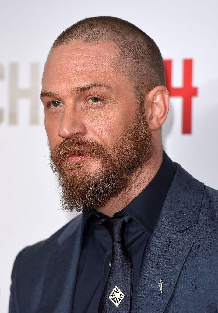 <p><strong>As seen on Tom Hardy</strong></p><p>As far as full beards go, this one is probably the easiest. You have to let the hair grow...and grow. And grow some more. You need considerable length for this, but once it's there, upkeep is minimal. While there is an obvious shape to this beard (longer on the shin, shorter on the sides), it's not manicured. Shape it with a trimmer about once a week and in the meantime, let it do its thing. It looks best with a very short buzz on top, but also works well with a completely bald head.</p>