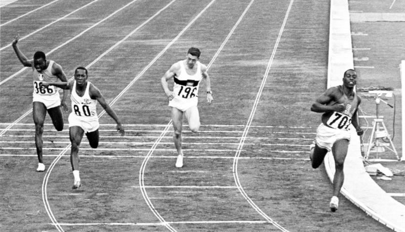 FILE - In an Oct. 15, 1964, file photo, United States' Bob Hayes, far right, crosses the finish line ahead of Ivory Coast's Gaoussou Kone, far left, Cuba's Enrique Figuerola, second from left, and Germany's Heinz Schumann (196) to win the men's 100-meter dash finals at the 1964 Tokyo Summer Olympics. Hayes' gold medal in the 100 meters earned him the designation of the world's fastest human and provided him the opportunity to become the first Olympic champion to make it big in professional football as a wide receiver for nine years with the Dallas Cowboys, and a two-time All-Pro. With the 2012 London Summer Olympics over, The Associated Press takes a look at six teams that could look to copy Hayes' success by pursuing Jamaican runner Usain Bolt. (AP Photo, File)