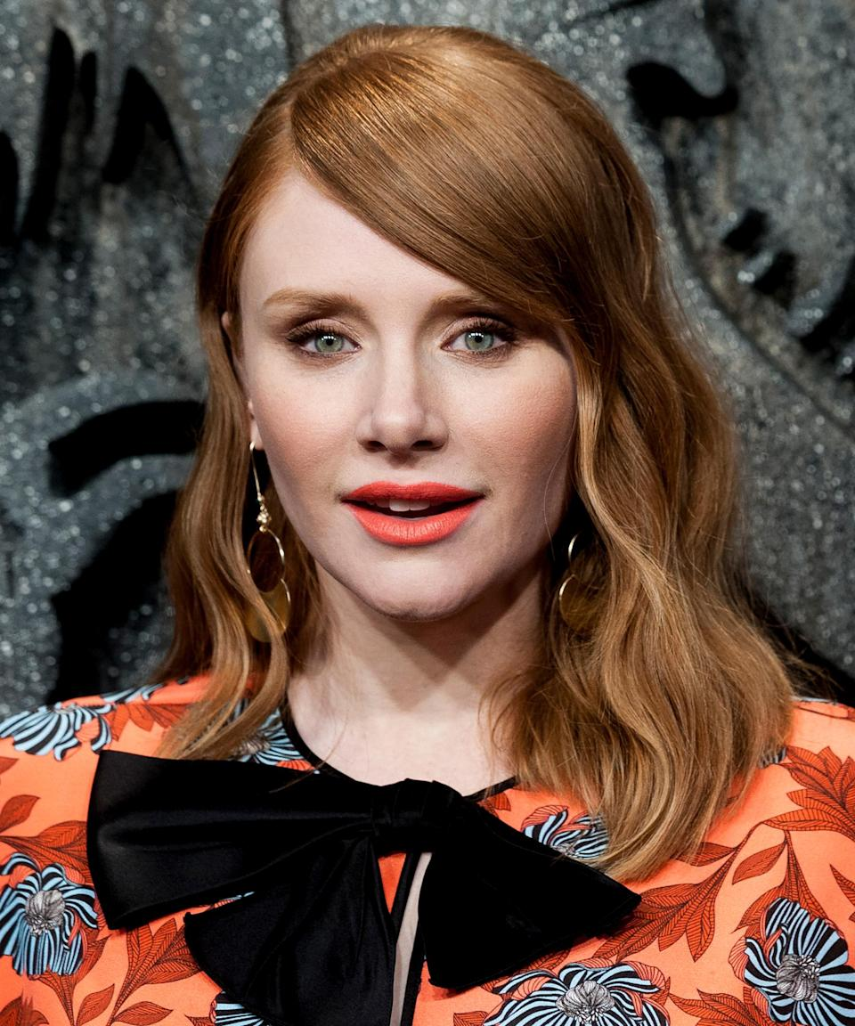 """<strong><h2>Bryce Dallas Howard</h2></strong><a href=""""https://www.glamour.com/story/bryce-dallas-howard-red-hair-secrets"""" rel=""""nofollow noopener"""" target=""""_blank"""" data-ylk=""""slk:Howard is a natural redhead"""" class=""""link rapid-noclick-resp"""">Howard is a natural redhead</a>, but <a href=""""https://www.instagram.com/p/4UKBfMCg0y/?taken-by=traceycunningham1"""" rel=""""nofollow noopener"""" target=""""_blank"""" data-ylk=""""slk:Cunningham"""" class=""""link rapid-noclick-resp"""">Cunningham</a> is to credit for this lighter strawberry-blonde hue. A few years ago, the colorist revealed on Instagram that she used highlights to brighten Howard's naturally darker red hair.<span class=""""copyright"""">Photo: Juan Naharro Gimenez/Getty Images.</span>"""