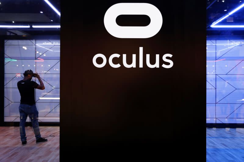 A man play a VR game on an Oculus as he attends E3, the annual video games expo revealing the latest in gaming software and hardware in Los Angeles