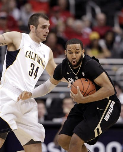 Colorado's Carlon Brown, right, is defended by California's Robert Thurman during the first half of an NCAA college basketball game in the semifinals of the Pac-12 conference championship in Los Angeles, Friday, March 9, 2012. (AP Photo/Jae C. Hong)