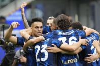 Inter Milan's Lautaro Martinez, left, celebrates with teammates after scoring his side's first goal during an Italian Serie A soccer match between Inter Milan and Atalanta, at the San Siro stadium in Milan, Italy, Saturday, Sept. 25, 2021. (AP Photo/Luca Bruno)