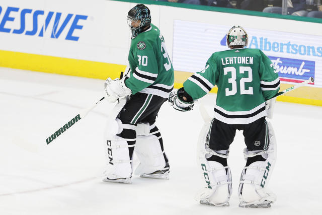 Dallas Stars goaltender Kari Lehtonen (32) is pulled from an NHL hockey game and replaced by goaltender Ben Bishop (30) after giving up four goals during the second period against the Winnipeg Jets, Saturday, Feb. 24, 2018, in Dallas. (AP Photo/Brandon Wade)