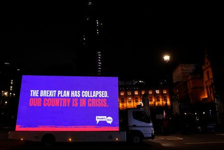 A truck with a sign passes by the Houses of Parliament after the result was announced on Prime Minister Theresa May's Brexit deal, in London, Britain, January 15, 2019. REUTERS/Clodagh Kilcoyne