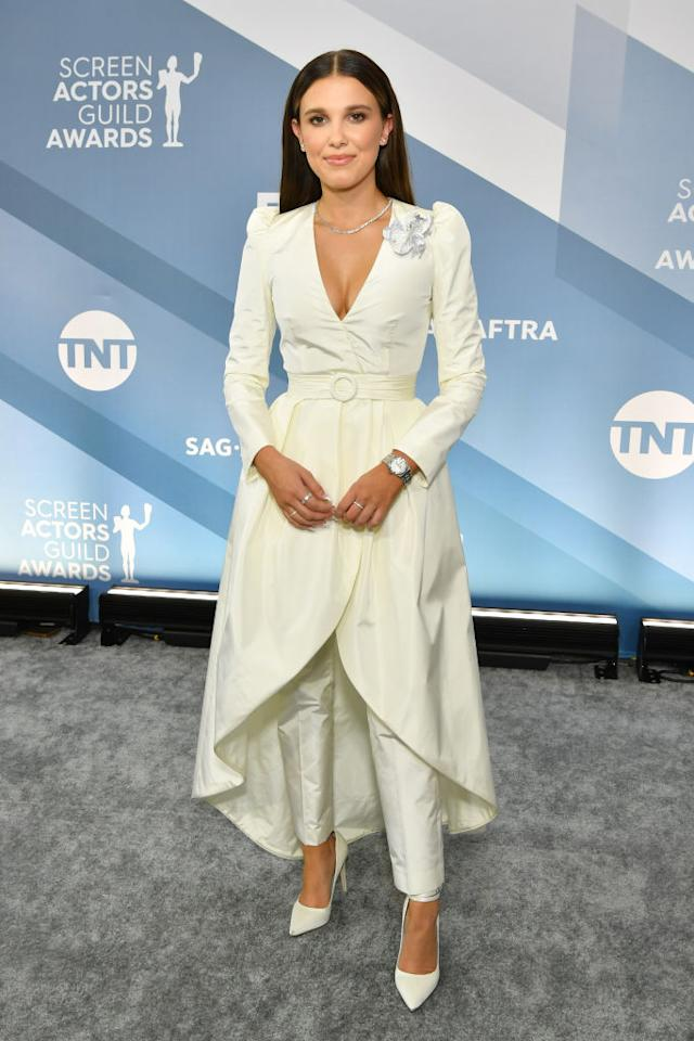 The 15-year-old absolutely killed it in an all-white jacket-over-trousers combo, later removing her jacket to reveal a strapless crop top. [Photo: Getty]