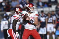 Houston quarterback Logan Holgorsen lines up tp pass during the second half of an NCAA college football game against Connecticut, Saturday, Oct. 19, 2019, in East Hartford, Conn. (AP Photo/Stephen Dunn)