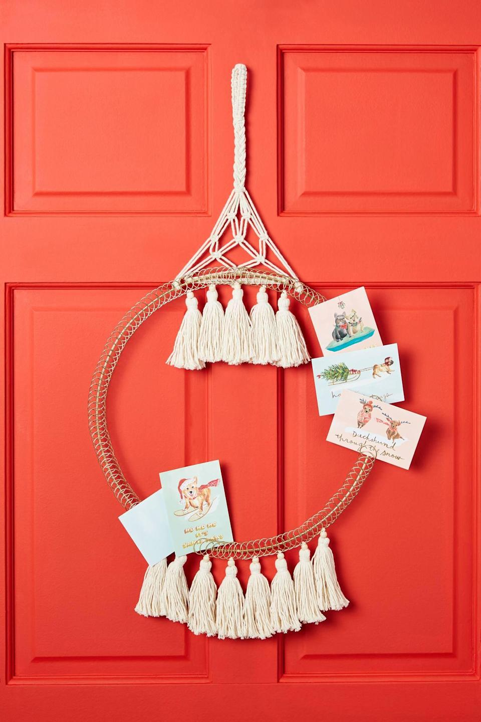 """<p>Use your holiday cards as decoration with the <a href=""""https://www.popsugar.com/buy/Macrame-Greeting-Card-Holder-490538?p_name=Macrame%20Greeting%20Card%20Holder&retailer=anthropologie.com&pid=490538&price=68&evar1=casa%3Aus&evar9=46615300&evar98=https%3A%2F%2Fwww.popsugar.com%2Fhome%2Fphoto-gallery%2F46615300%2Fimage%2F46615409%2FMacrame-Greeting-Card-Holder&list1=shopping%2Canthropologie%2Choliday%2Cchristmas%2Cchristmas%20decorations%2Choliday%20decor%2Chome%20shopping&prop13=mobile&pdata=1"""" rel=""""nofollow noopener"""" class=""""link rapid-noclick-resp"""" target=""""_blank"""" data-ylk=""""slk:Macrame Greeting Card Holder"""">Macrame Greeting Card Holder</a> ($68).</p>"""