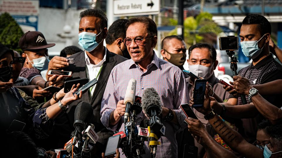 KUALA LUMPUR, MALAYSIA - OCTOBER 16: Anwar Ibrahim, head of Malaysia's main opposition, speaks to press members after he was summoned by Malaysian police to give a statement regarding a viral list of federal parliamentarians who allegedly back his bid to claim the premiership, in Kuala Lumpur, Malaysia on October 16, 2020. (Photo by Syaiful Redzuan/Anadolu Agency via Getty Images)