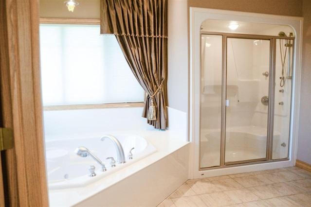 <p><span>15 Briarwood Way, Stony Plain, Alta.</span><br> The master ensuite, one of four-and-a-half bathrooms in the home, has an air-jet tub.<br> (Photo: Zoocasa) </p>