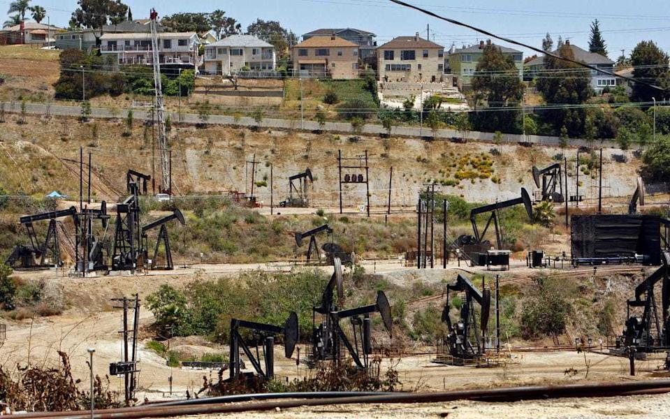Homes overlook the Inglewood Oil Field in the Los Angeles area.