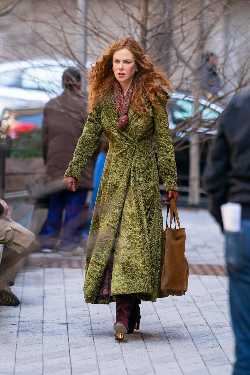 """<p>Remember how I mentioned that the green material is thick? Get this: in total, the coat weighs a whopping 15 pounds, Signe estimated. """"You can almost see how heavy it is when she walks around,"""" she said.</p>"""