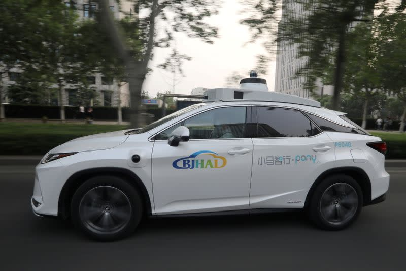 FILE PHOTO: A Lexus vehicle equipped with Pony.ai's autonomous driving system drives on a road during a test in Beijing