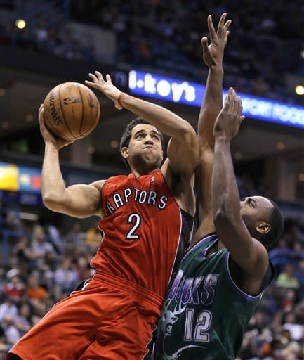 Toronto Raptors' Landry Fields (2) drives against Milwaukee Bucks' Luc Richard Mbah a Moute, right, during the first half of an NBA basketball game Saturday, March 2, 2013, in Milwaukee. (AP Photo/Jeffrey Phelps)
