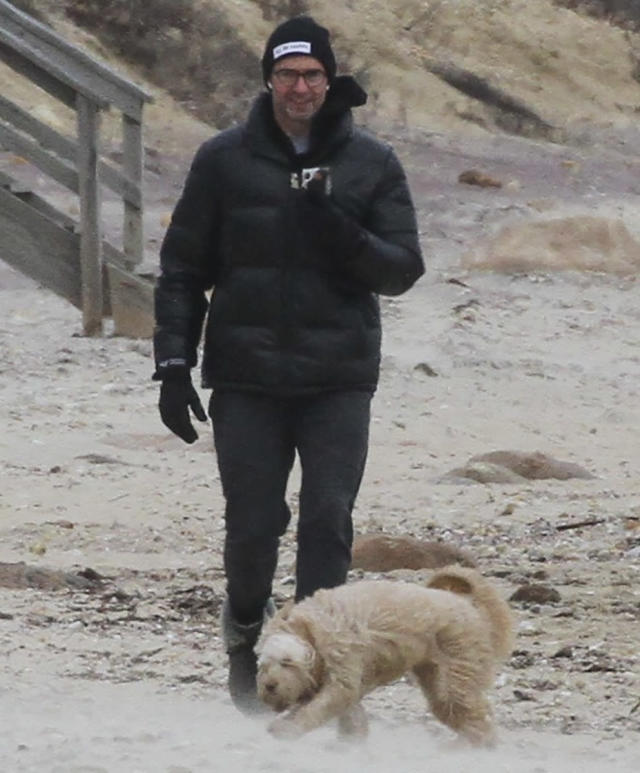 <p>Hugh Jackman bundles up to walk his dog on the beach in The Hamptons, New York, on Monday.</p>
