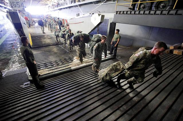 <p>The Army's 602nd Area Support Medical Company boards the U.S.S. Kearsarge aircraft carrier from a Navy landing craft during their evacuation from the U.S. Virgin Islands in advance of Hurricane Maria, Sept.17, 2017. (Photo: Jonathan Drake/Reuters) </p>