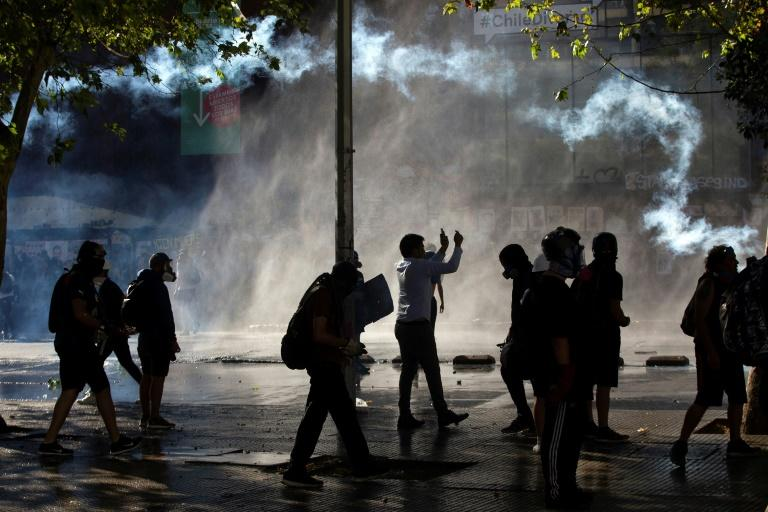 Police used water cannon and tear gas to disperse demonstrators in Chile's capital Santiago