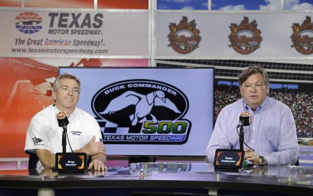 Greg Stucker, right, Goodyear director of race tire sales, and Robin Pemberton, NASCAR vice-president of competition and racing development, speak with reporters at Texas Motor Speedway in Fort Worth, Texas, Friday, April 4, 2014. NASCAR will not regulate tire pressures at the speedway, and if drivers have tire failures during Sunday's race officials believe they will not be able to blame Goodyear. (AP Photo/LM Otero)