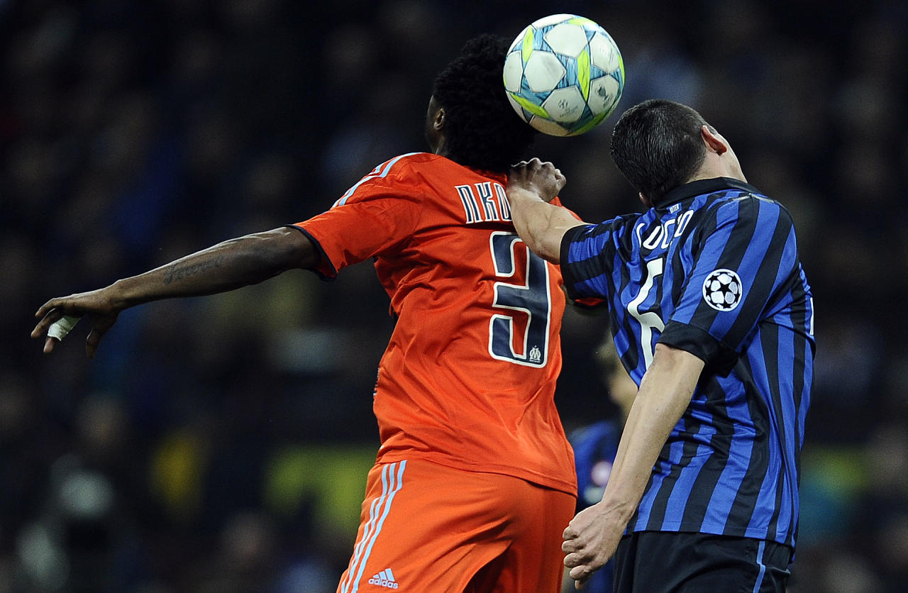 Marseille's Cameroonian defender Nicolas Nkoulou (L) vies with Inter Milan's Serbian midfielder Dejan Stankovic during their second leg Champions League round of 16 football match in Milan's San Siro Stadium on March 13, 2012. AFP PHOTO / Filippo MONTEFORTE (Photo credit should read FILIPPO MONTEFORTE/AFP/Getty Images)