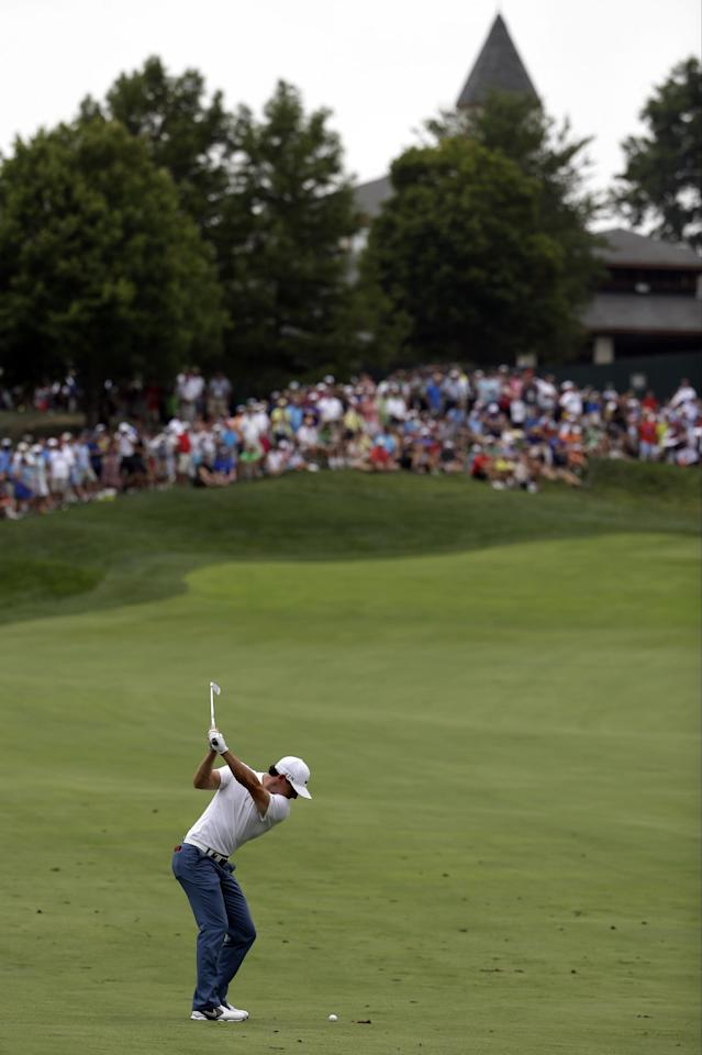 Rory McIlroy, of Northern Ireland, hits from the fairway on the ninth hole during a practice round for the PGA Championship golf tournament at Valhalla Golf Club on Tuesday, Aug. 5, 2014, in Louisville, Ky. The tournament is set to begin on Thursday. (AP Photo/David J. Phillip)