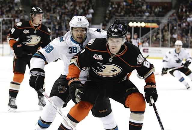 San Jose Sharks' Bracken Kearns, left, and Anaheim Ducks' Luca Sbisa, of Italy, go after the puck during the first period of an NHL hockey game on Tuesday, Dec. 31, 2013, in Anaheim, Calif. (AP Photo/Jae C. Hong)