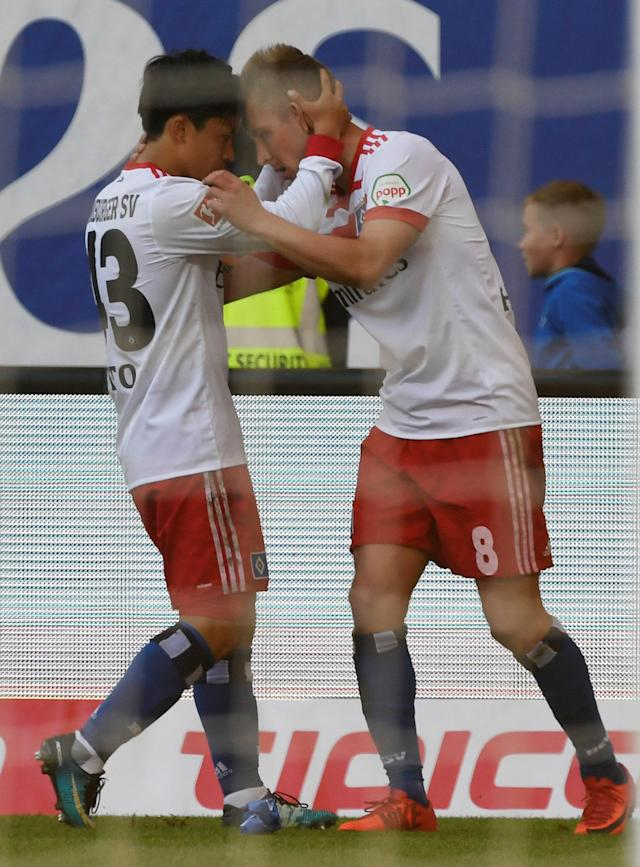 Soccer Football - Bundesliga - Hamburger SV v Borussia Moenchengladbach - Volksparkstadion, Hamburg, Germany - May 12, 2018 Hamburg's Lewis Holtby celebrates scoring their second goal with Tatsuya Ito REUTERS/Fabian Bimmer DFL RULES TO LIMIT THE ONLINE USAGE DURING MATCH TIME TO 15 PICTURES PER GAME. IMAGE SEQUENCES TO SIMULATE VIDEO IS NOT ALLOWED AT ANY TIME. FOR FURTHER QUERIES PLEASE CONTACT DFL DIRECTLY AT + 49 69 650050