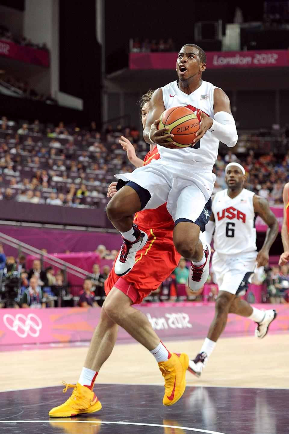 LONDON, ENGLAND - AUGUST 12: Chris Paul #13 of the United States takes the ball to the basket during the Men's Basketball gold medal game between the United States and Spain on Day 16 of the London 2012 Olympics Games at North Greenwich Arena on August 12, 2012 in London, England. (Photo by Harry How/Getty Images)