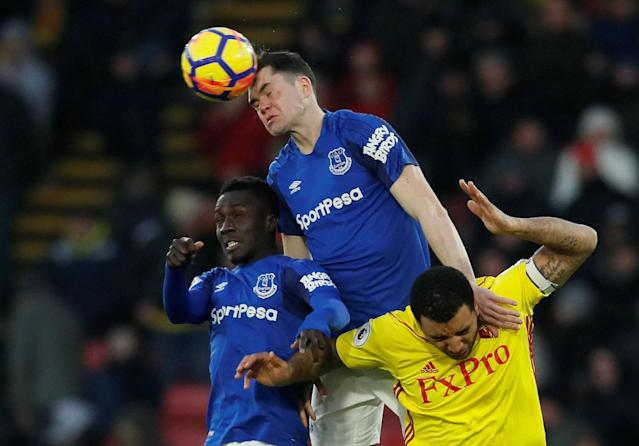 """Soccer Football - Premier League - Watford vs Everton - Vicarage Road, Watford, Britain - February 24, 2018 Everton's Idrissa Gueye and Michael Keane in action with Watford's Troy Deeney REUTERS/David Klein EDITORIAL USE ONLY. No use with unauthorized audio, video, data, fixture lists, club/league logos or """"live"""" services. Online in-match use limited to 75 images, no video emulation. No use in betting, games or single club/league/player publications. Please contact your account representative for further details."""