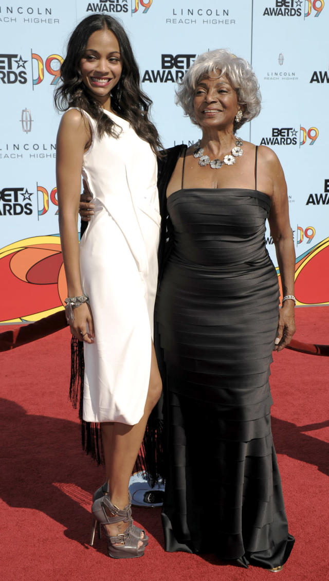<p><em><em>Saldana and Nichelle Nichols — who originated the role of Uhura in <em>Star Trek</em> — were presenters at the 9th Annual BET Awards on June 28, 2009. (Photo: Dan Steinberg/AP) </em></em></p>