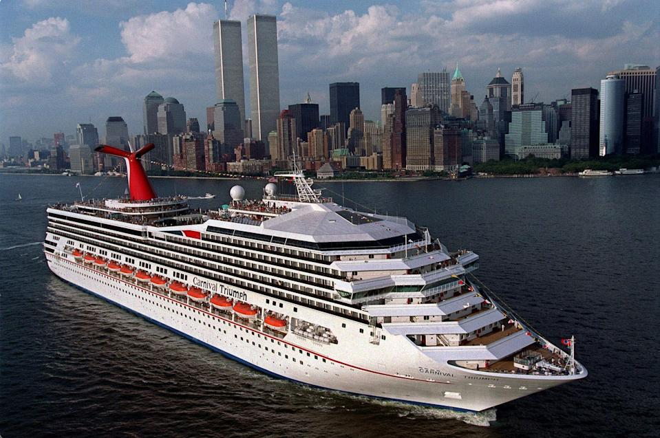 File - This July 27, 1999 handout file photo provided by Carnival Cruise Lines shows the MS Carnival Triumph departing New York harbor, on her inaugural voyage. Carnival Cruise Lines said Sunday an engine room fire had disabled the cruise ship Triumph about 150 miles off the Yucatan Peninsula with 3,143 passengers and 1,086 crew members on board. The U.S. Coast Guard says tug boats are scheduled to reach Triumph about noon Monday. The cruise ship with 3,143 passengers and 1,086 crew members will be towed to Progreso, Mexico. (AP Photo/Carnival Lines, Andy Newman, File)