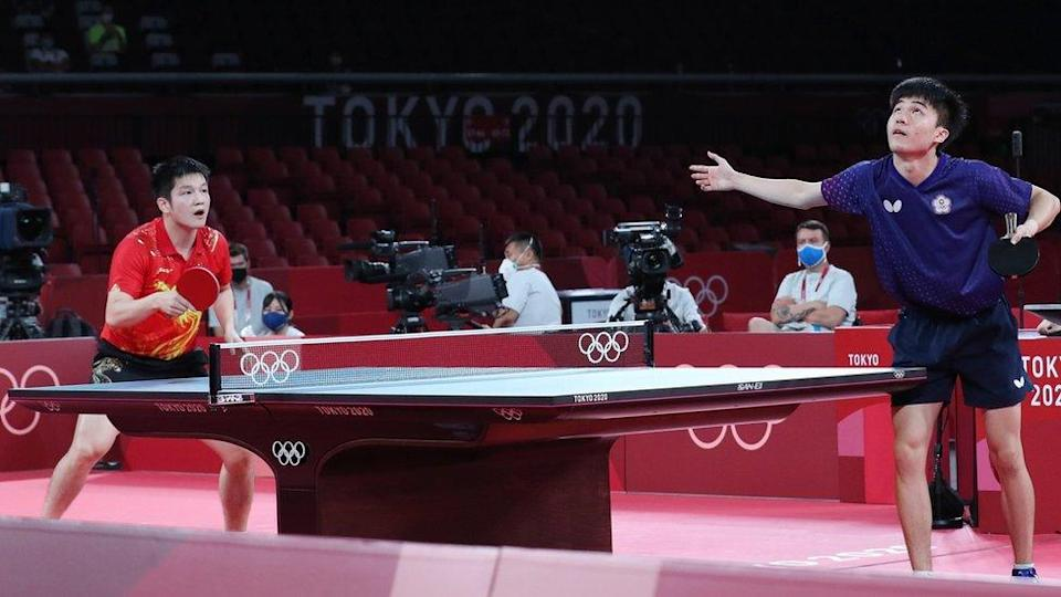 an Zhendong of China (L) in action against Lin Yun Ju of Chinese Taipei (R) during the Table Tennis Men