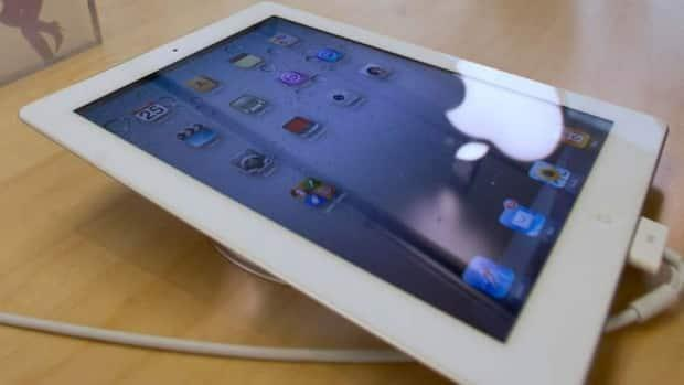 Used Apple products such as iPads have been targetted by thieves who use buy-and-sell platforms to find their victims, say Calgary police. (Paul White/The Associated Press - image credit)