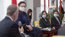 In this photo released by the Taiwan Presidential Office, President Tsai Ing-wen, second right, and Foreign Minister Joseph Wu, right, listen as U.S. Republican Sen. Dan Sullivan of Alaska at left speaks next to Democratic Sen. Tammy Duckworth of Illinois in Taipei, Taiwan, on Sunday, June 6, 2021. The U.S. will give Taiwan 750,000 doses of COVID-19 vaccine, part of President Joe Biden's move to share tens of millions of jabs globally, three American senators said Sunday, after the self-ruled island complained that China is hindering its efforts to secure vaccines as it battles an outbreak. (Taiwan Presidential Office via AP)