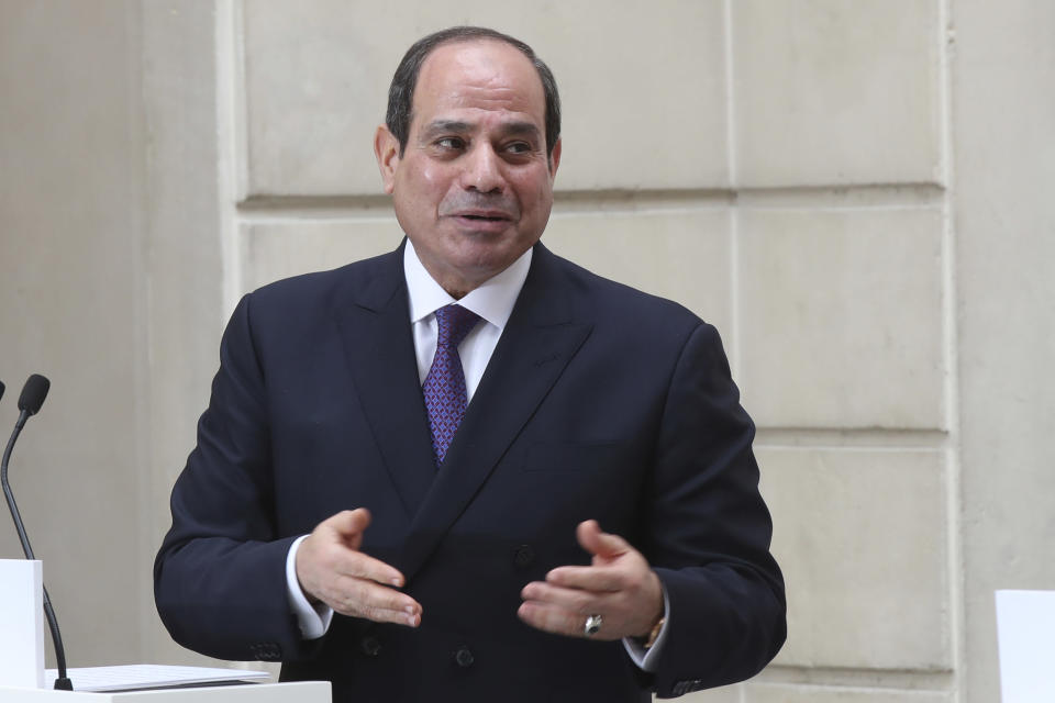 FILE - In this Dec. 7, 2020, file photo, Egyptian President Abdel Fattah el-Sissi speaks during a joint press conference with French President Emmanuel Macron at the Elysee palace in Paris. Egypt's president arrived in Sudan on Saturday, March 6, 2021, his first visit to the country since a popular uprising led to the military's overthrow of longtime autocrat Omar al-Bashir in 2019.(AP Photo/Michel Euler, File)