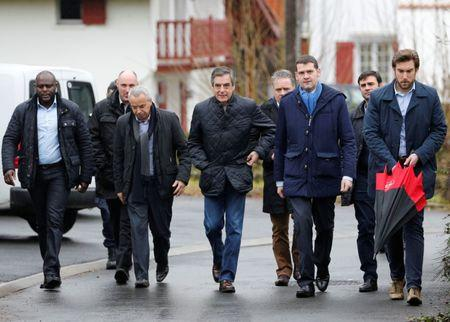 Francois Fillon (C), former French Prime Minister, member of the Republicans political party and 2017 presidential election candidate of the French centre-right walks in a street with security members and staff members in Cambo les Bains, France 2017. REUTERS/Regis Duvignau -