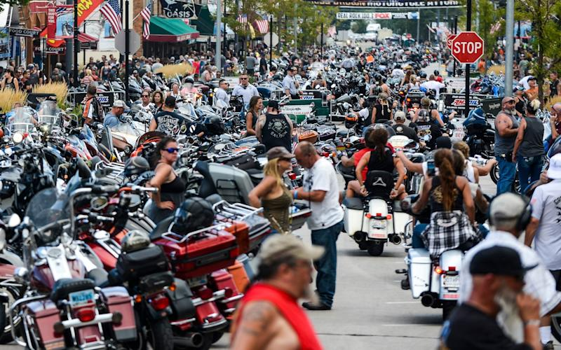 Motorcycles and people crowd Main Street during the 80th Annual Sturgis Motorcycle Rally on August 7 - Getty