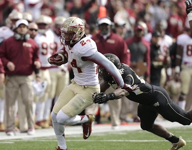 Florida State linebacker Terrence Smith carries the ball after intercepting a Wake Forest pass in the first half of an NCAA college football game in Winston-Salem, N.C., Saturday, Nov. 9, 2013. (AP Photo/Nell Redmond)