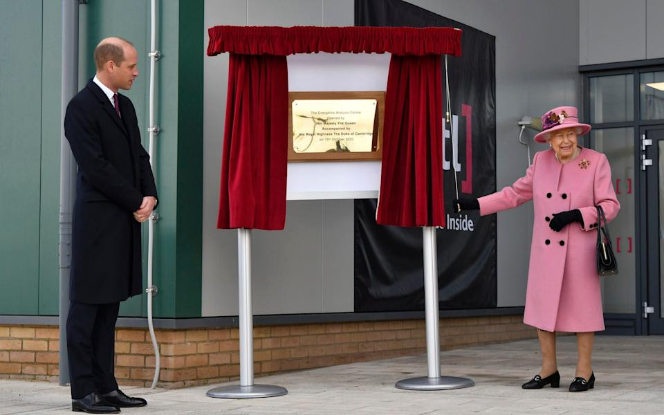 Britain's Prince William looks on as Queen Elizabeth II unveils a plaque to officially open the new Energetics Analysis Centre at the Defence Science and Technology Laboratory (DSTL) at Porton Down, England. - Ben Stansall/Pool via AP