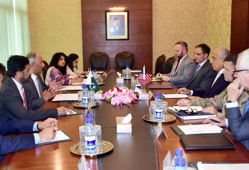 In this photo released by the Foreign Office, Special Representative for Afghanistan Reconciliation Zalmay Khalilzad, third from right, holds talks with Pakistani officials at the Foreign Minister in Islamabad, Pakistan, Sunday, June 2, 2019. Khalilzad has met Pakistani officials to find a peaceful solution to neighboring Afghanistan's war. (Pakistan Foreign Office via AP)